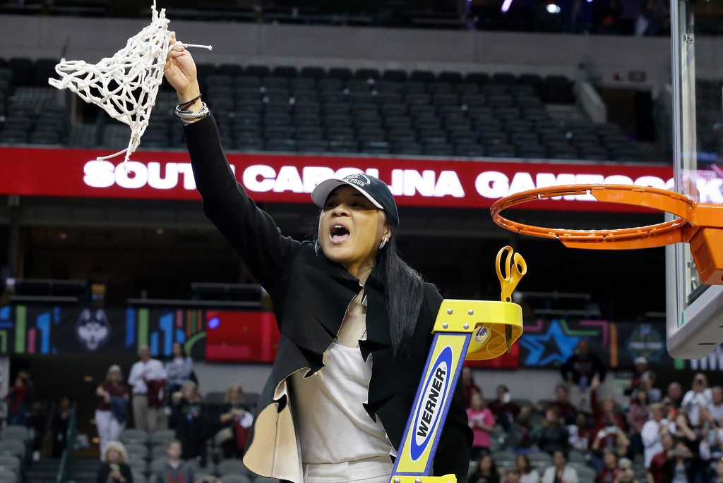 . South Carolina coach Dawn Staley cuts down the net as she and the team celebrate their win over Mississippi State in the final of NCAA women\'s Final Four college basketball tournament, Sunday, April 2, 2017, in Dallas. South Carolina won 67-55. (AP Photo/LM Otero)