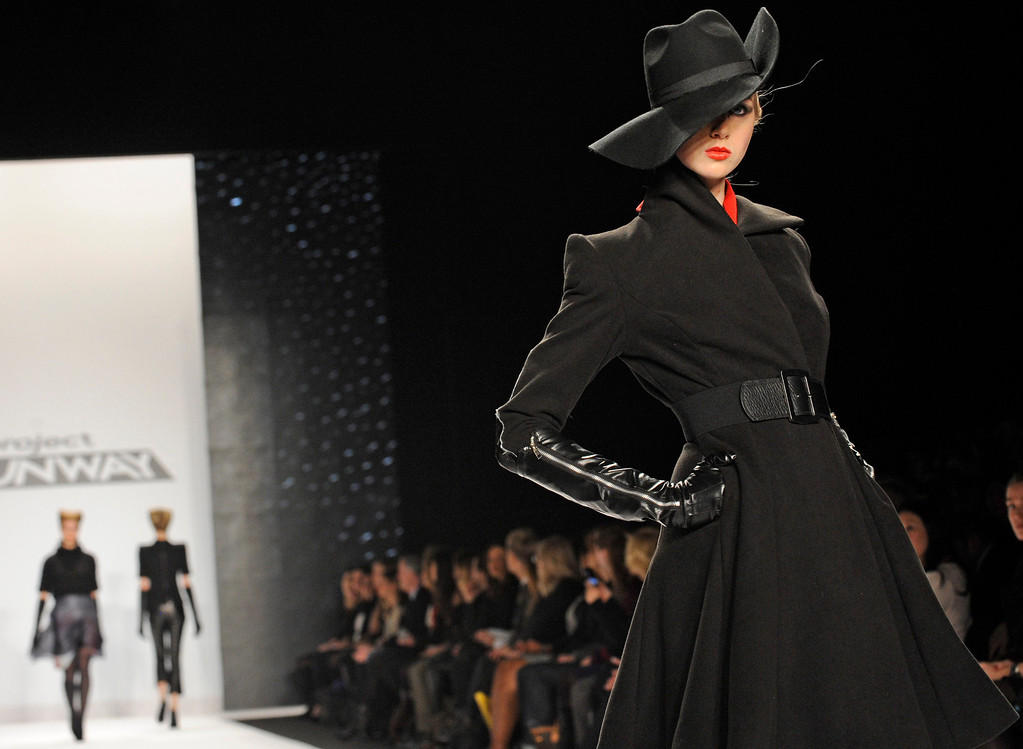 ". Fashion by the finalists of  ""The Project Runway\"" fashion competition series is modeled during Fashion Week, Friday Feb. 8, 2013, in New York. (AP Photo/Louis Lanzano)"