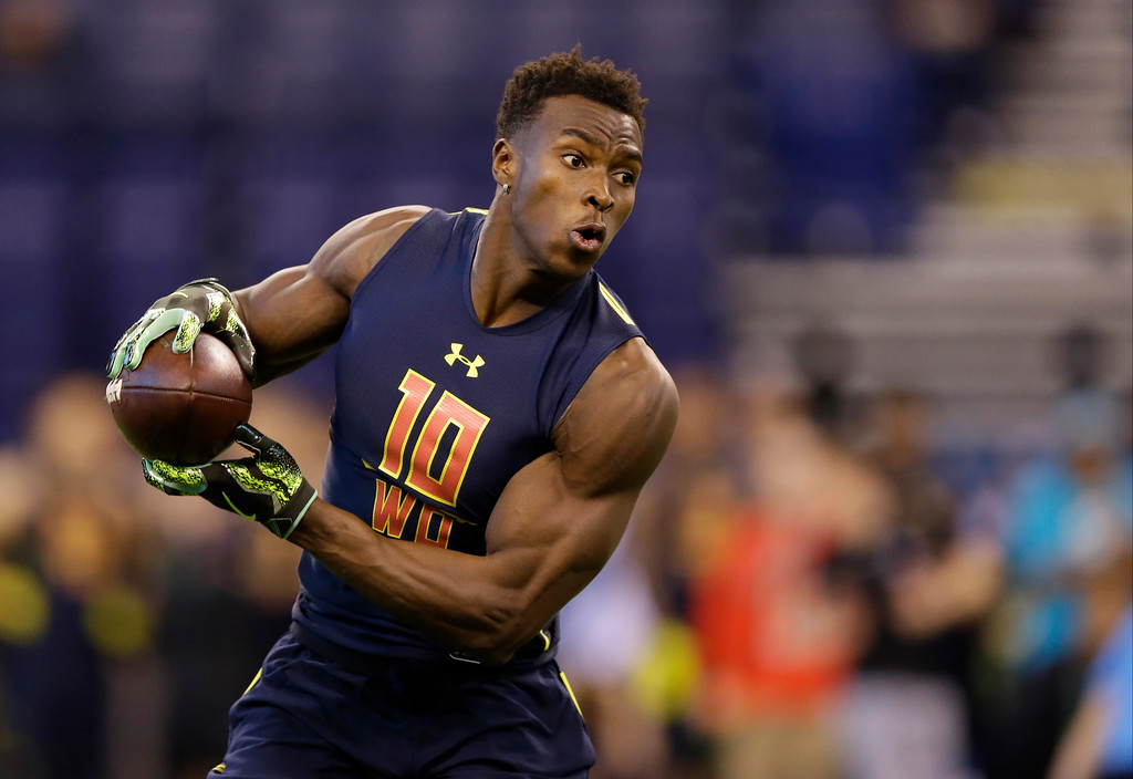 . Michigan wide receiver Amara Darboh runs a drill at the NFL football scouting combine in Indianapolis, Saturday, March 4, 2017. (AP Photo/Michael Conroy)