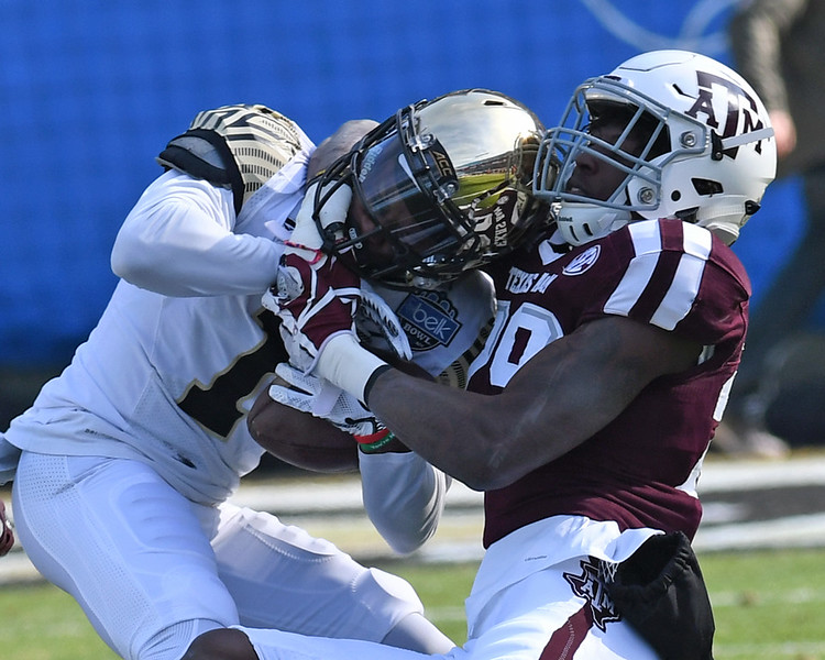 Tabari Hines wrestled down after catch 02.jpg
