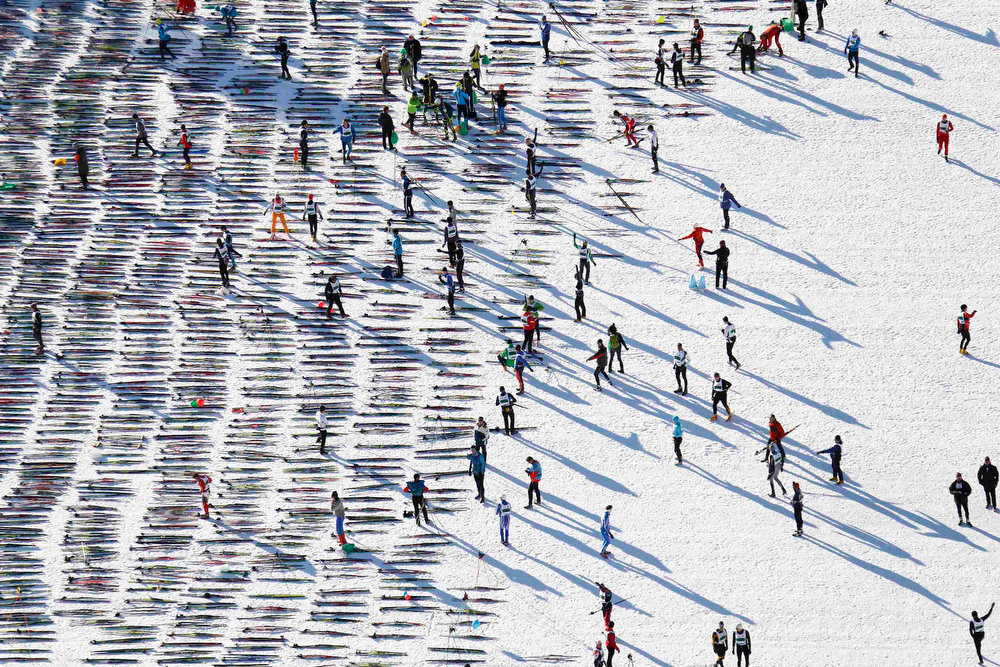. An aerial view shows cross-country skiers awaiting the start of the Engadin Ski Marathon on the frozen Lake Sils near the village of Maloja March 10, 2013. More than 12,000 skiers participated in the 26.2 miles race between Maloja and S-chanf near the Swiss mountain resort of St. Moritz. REUTERS/Michael Buholzer
