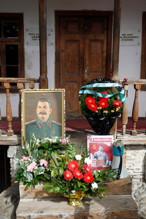 . Flowers are left in front of the house where the late Soviet leader Josef Stalin was born, on the 60th anniversary of Stalin\'s death, in his hometown of Gori, about 50 miles west of Georgia\'s capital, Tbilisi, on March 5, 2013. REUTERS/David Mdzinarishvili