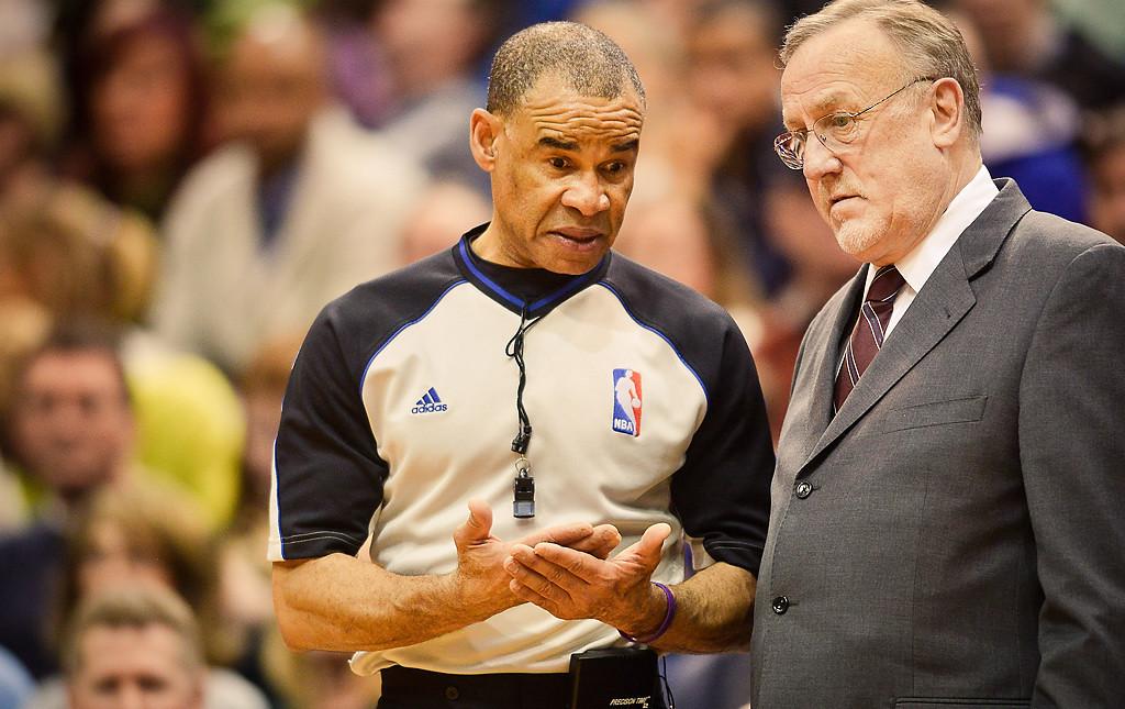 . Referee Dan Crawford speaks with Minnesota Timberwolves head coach Rick Adelman in the second half. (Pioneer Press: Ben Garvin)