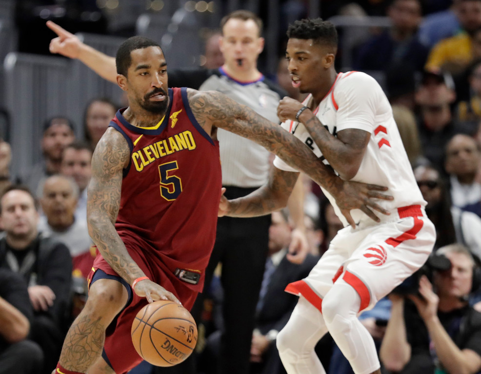 . Cleveland Cavaliers\' JR Smith (5) drives against Toronto Raptors\' Delon Wright (55) in the first half of an NBA basketball game, Wednesday, March 21, 2018, in Cleveland. (AP Photo/Tony Dejak)