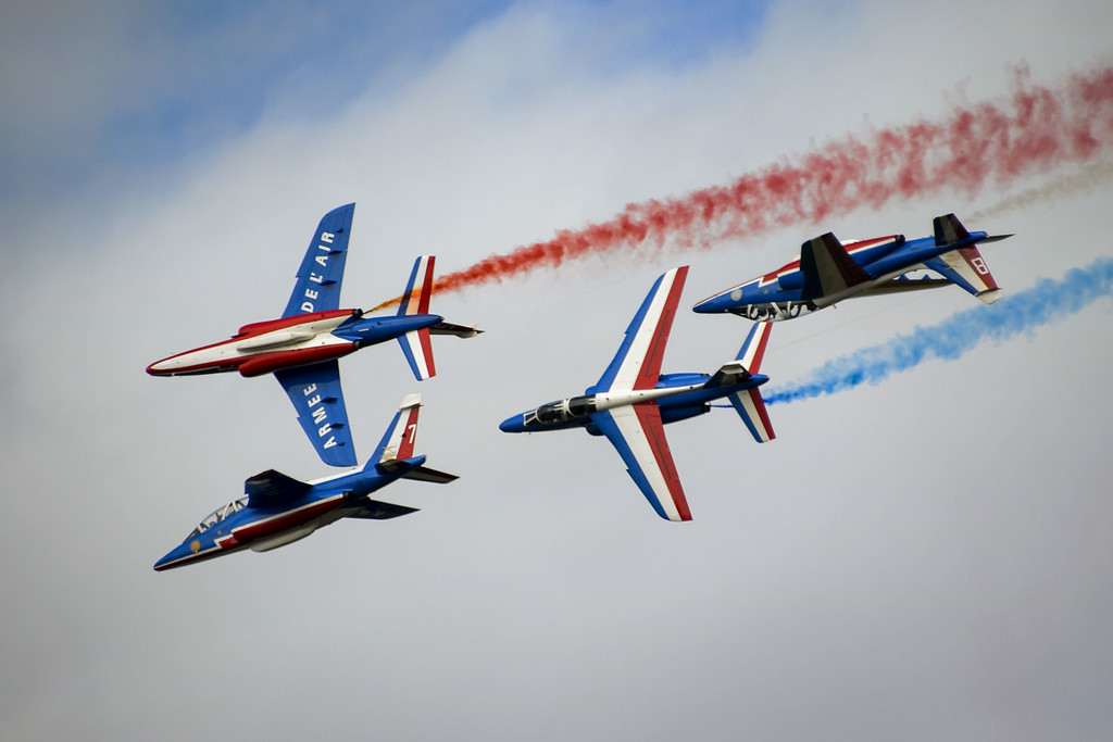 ". Fighter jets of the ""The Patrouille de France\"" perform during the first day of AIR14 air show on August 30, 2014 in Payerne, western Switzerland.  AFP PHOTO / FABRICE COFFRINI/AFP/Getty Images"