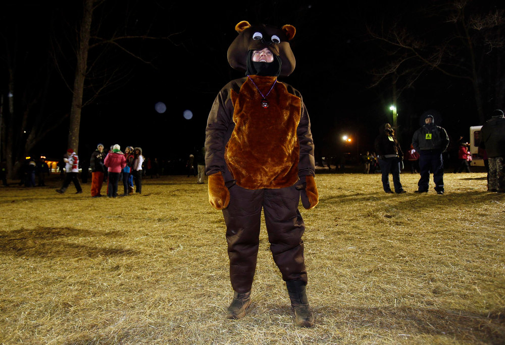 . Katie Wolf of South Bound Brook, New Jersey waits for the weather-prognosticating groundhog, Punxsutawney Phil, to make his annual prediction on Gobbler\'s Knob in Punxsutawney, Pennsylvania, on the 127th Groundhog Day February 2, 2013.  REUTERS/Jason Cohn