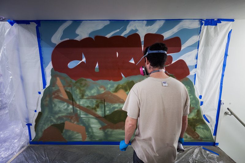 Graffiti artist working on an art installation in a Harlem pediatric clinic under the guidence of Hugo Martinez