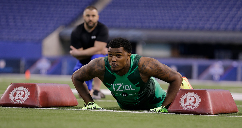 . Clemson defensive lineman Corey Crawford runs a drill at the NFL football scouting combine in Indianapolis, Sunday, Feb. 22, 2015. (AP Photo/David J. Phillip)