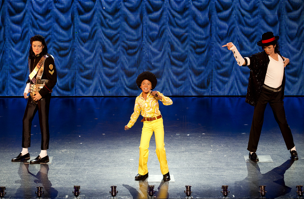 . Three wax figures of late pop icon Michael Jackson, created by Madame Tussauds Museum, are displayed on the stage of \'Thriller Live!\' West End show in London on June 24, 2013.         (JUSTIN TALLIS/AFP/Getty Images)