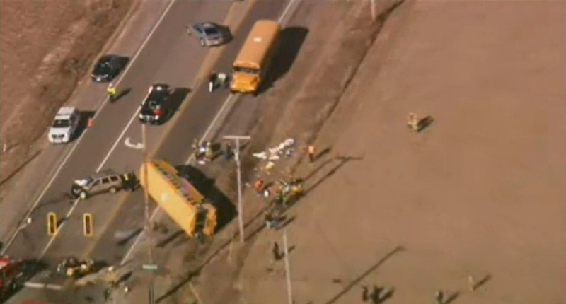 . A school bus lays on its side after being overturned following a collision, in Wadsworth, Illinois, as pictured in this frame taken from video courtesy of www.nbcchicago.com, April 5, 2013. The bus was carrying about 25 children to an Illinois elementary school and overturned in a collision, killing at least one person in another vehicle involved in the crash, a Lake County Sheriff\'s spokeswoman said on Friday. REUTERS/www.nbcchicago.com/Handout