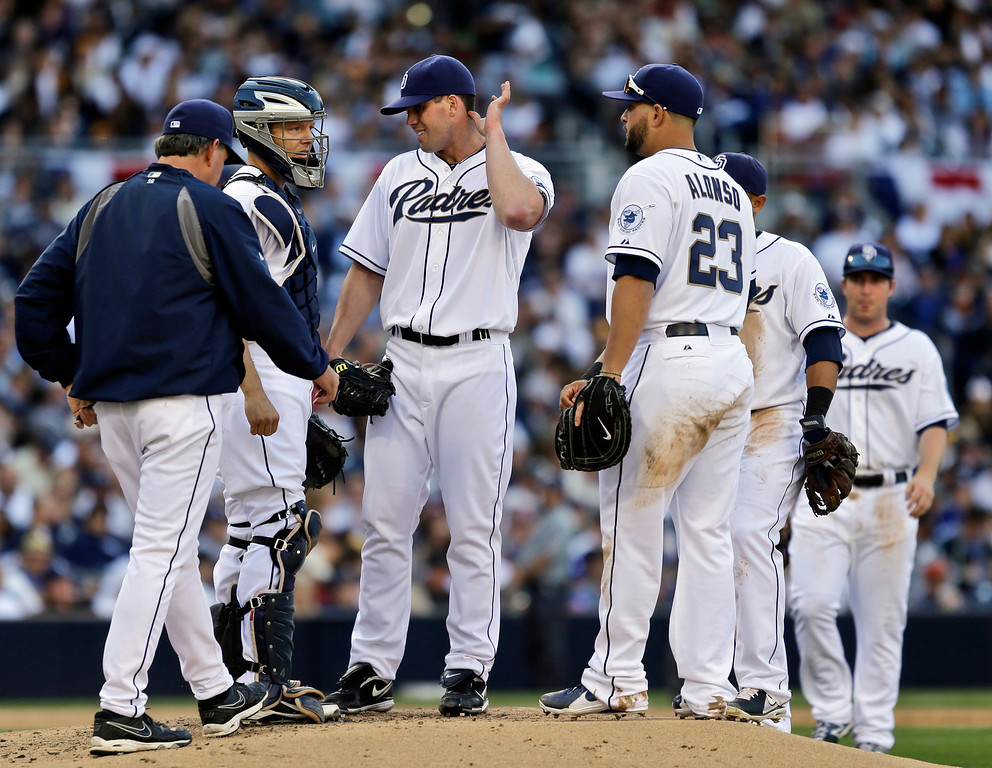 . San Diego Padres pitching coach Darren Balsley, left, makes a mound visit to pitcher Clayton Richard during a fifth-inning jam against the Los Angeles Dodgers in a baseball game in San Diego, Tuesday, April 9, 2013. (AP Photo/Lenny Ignelzi)