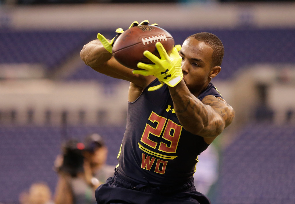 . Tulsa wide receiver Keevan Lucas runs a drill at the NFL football scouting combine in Indianapolis, Saturday, March 4, 2017. (AP Photo/Michael Conroy)