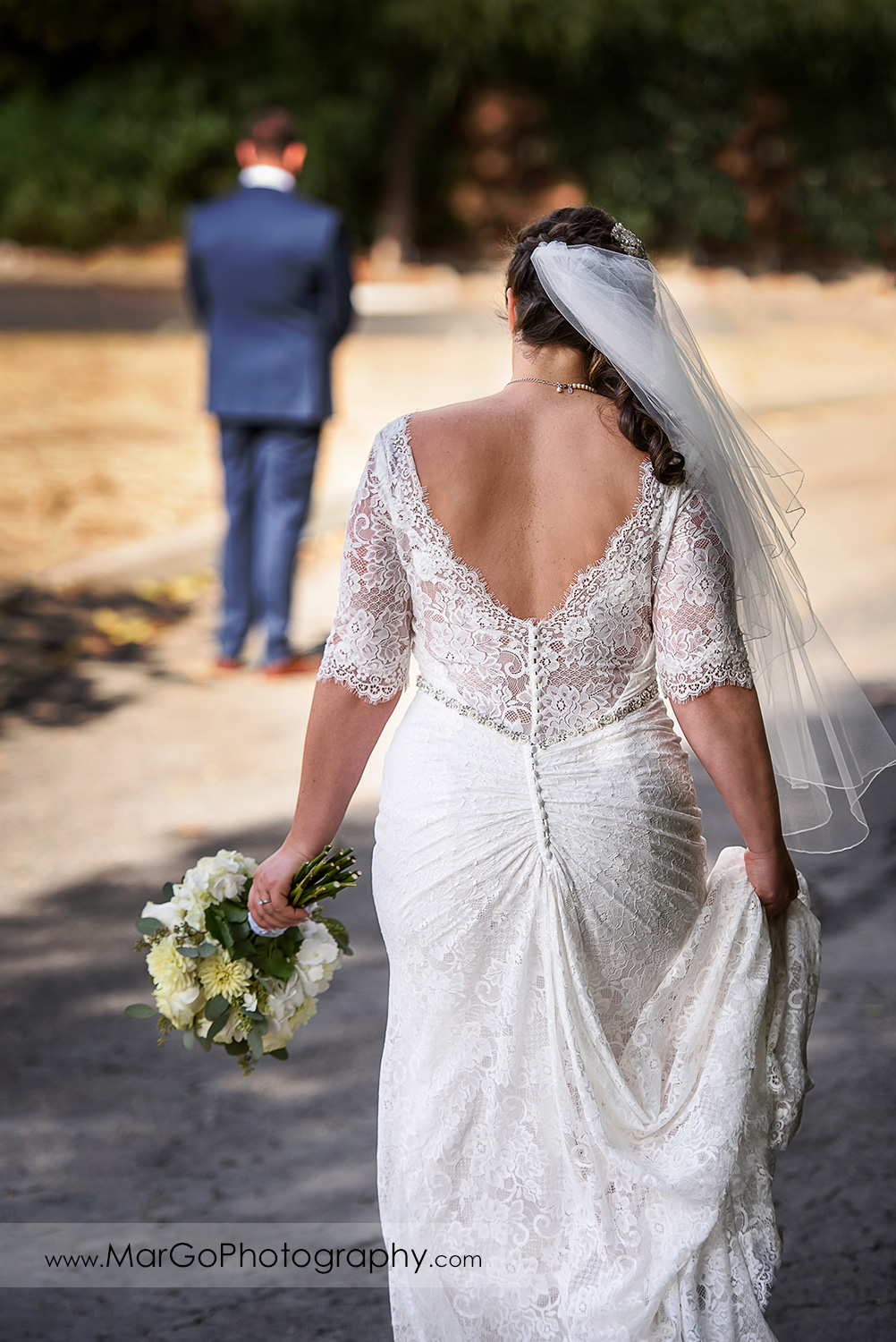 back view of bride approaching the groom during first look at Los Gatos Lodge