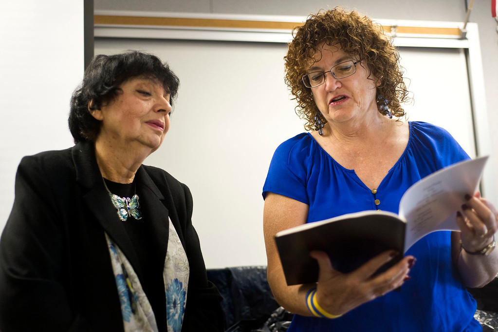 . Art teacher Elaine Stricklin, right, gives a book of poems inspired by Inge Auerbacher, left, poetries during her visit at Sierra High School in Glendora on Tuesday, Nov. 12, 2013. Auerbacher told her stories about the time she spent in the Terezin concentration camp. (Photo by Watchara Phomicinda/San Gabriel Valley Tribune)