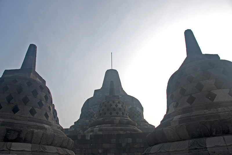 More stupas forming a silhouette against clear sky in Borobudur temple