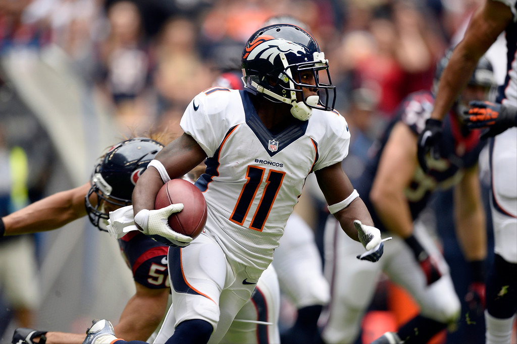 . Denver Broncos wide receiver Trindon Holliday (11) picks up a big gain during a punt return during the first quarter against the  Houston Texans December 22, 2013 at Reliant Stadium. (Photo by John Leyba/The Denver Post)