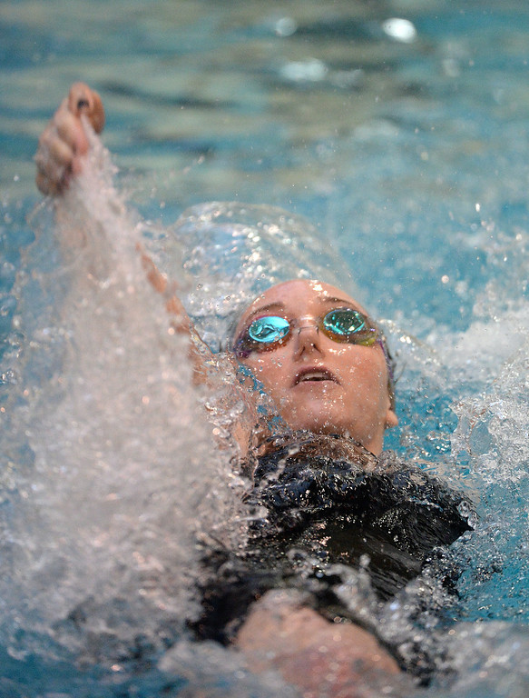 . THORNTON, CO. - FEBRUARY 15, 2014: Rock Canyon High School swimmer Abigail Kochevar cut through the water during her win in the 100-yard backstroke event. The CHSAA 5A Girl\'s State Swimming Championships wrapped up Saturday night February 14, 2104.  Photo By Karl Gehring/The Denver Post