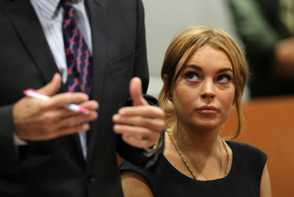 Description of . Troubled actress Lindsay Lohan appears in court for a pretrial hearing before Judge Stephanie Sautner at the Airport Branch Courthouse of Los Angeles Superior Court on January 30, 2013 in Los Angeles, California. Lohan is charged with three misdemeanor counts involving a car crash - willfully resisting, obstructing or delaying an officer, providing false information to an officer and reckless driving. She is also accused of violating her probation in a misdemeanor jewelry theft case.  (Photo by David McNew/Getty Images)