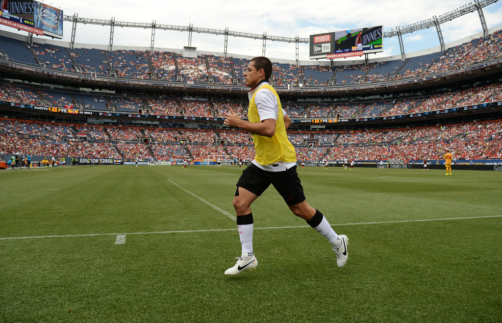 . Javier Hernandez of Manchester United (14)  warming up for the 2nd half of game against AS Roma at Sports Authority Field at Mile High in Denver, Colorado, July 26, 2014. (Photo by Hyoung Chang/The Denver Post)