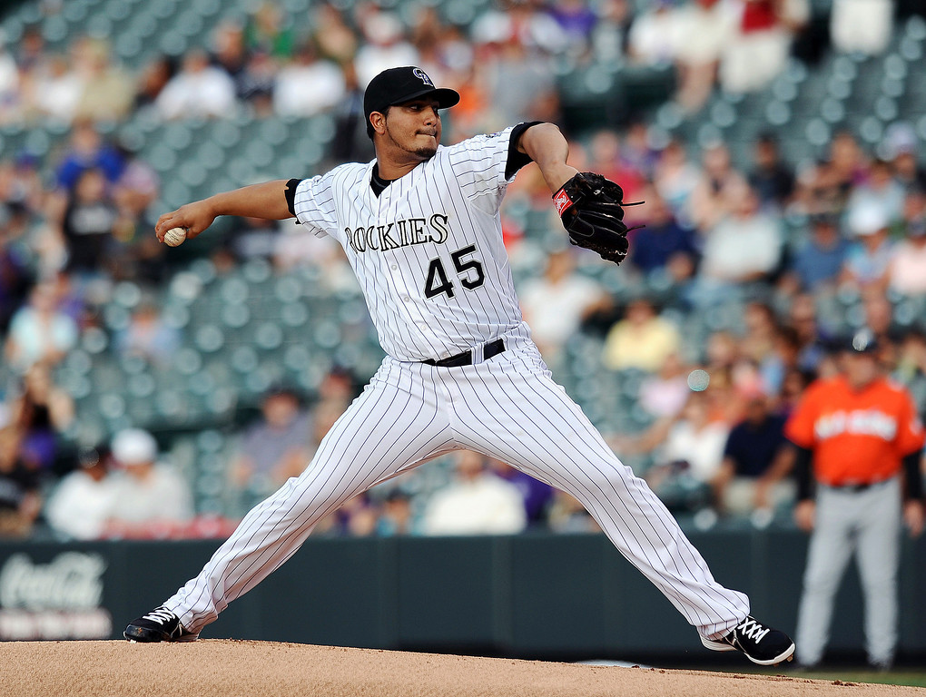 . Colorado Rockies starting pitcher Jhoulys Chacin throws in the first inning of a baseball game against the Miami Marlins on Tuesday, July 23, 2013, in Denver. (AP Photo/Chris Schneider)