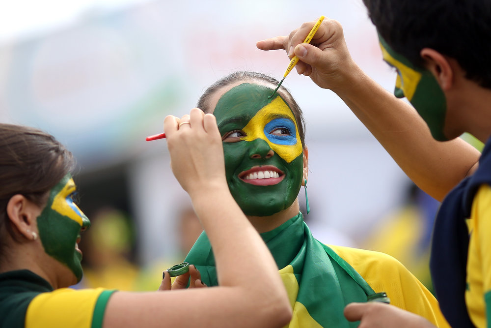 . Fans arrive before the Group A match between Brazil and Cameroon at Estadio Nacional on June 23, 2014 in Brasilia, Brazil. (Photo by Celso Junior/Getty Images)
