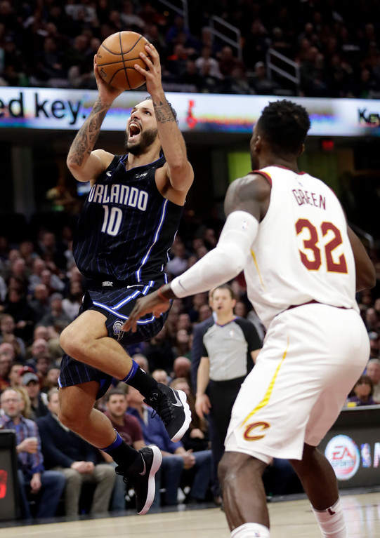 . Orlando Magic\'s Evan Fournier (10), from France, shoots against Cleveland Cavaliers\' Jeff Green (32) in the second half of an NBA basketball game, Thursday, Jan. 18, 2018, in Cleveland. (AP Photo/Tony Dejak)