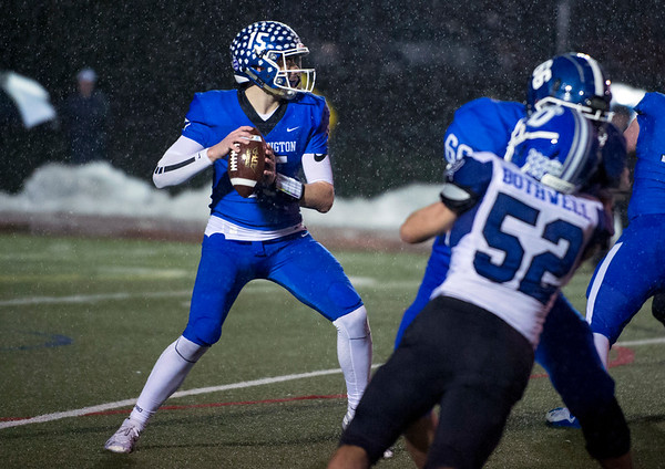 12/09/19 Wesley Bunnell | StaffrrSouthington football was defeated at home in a CIAC playoff game against Darien on a rainy Monday night December 9, 2019. Brady Lafferty (15) looks downfield for a receiver.