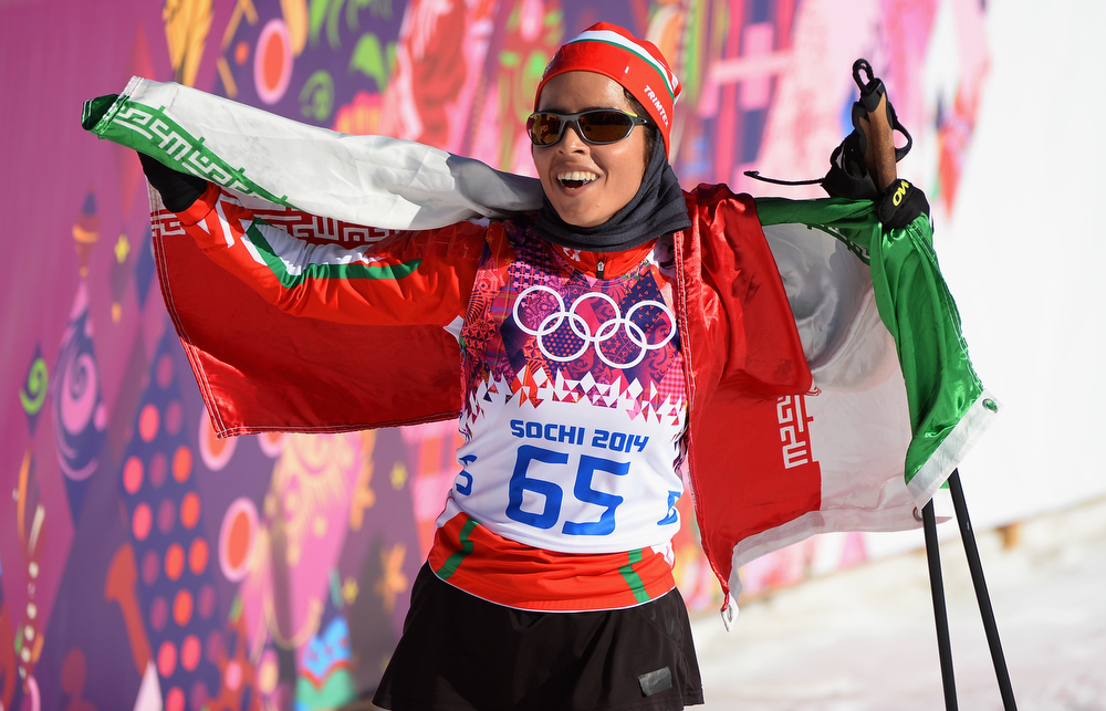 . Farzaneh Rezasoltani of Iran celebrates after competing in the Women\'s 10 km Classic during day six of the Sochi 2014 Winter Olympics at Laura Cross-country Ski & Biathlon Center on February 13, 2014 in Sochi, Russia.  (Photo by Harry How/Getty Images)
