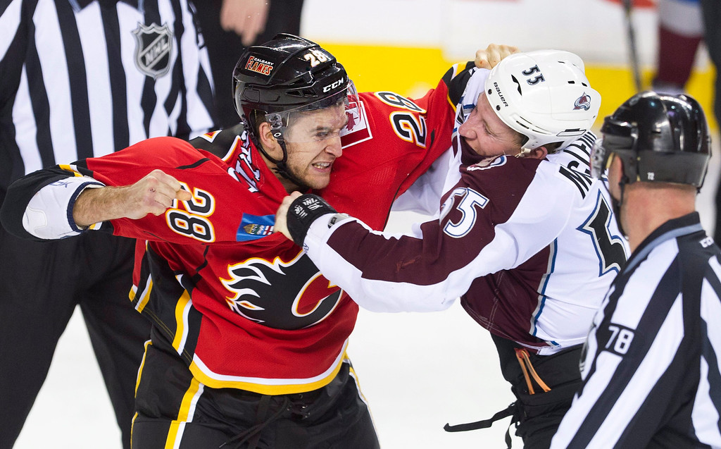 . Colorado Avalanche\'s Cody McLeod, right, fights with Calgary Flames\' Lane MacDermid during the first period of an NHL hockey game, Friday, Dec. 6, 2013 in Calgary, Alberta. (AP Photo/The Canadian Press, Larry MacDougal)