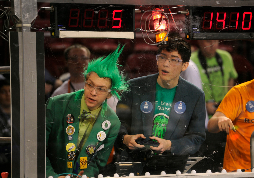 . DENVER, CO.- APRIL 6: Drivers from George Washington High School Nate Bloom, left, 17, and Zachary Kaluza, 16, navigate their robot during the competition. The Colorado Regional FIRST Robotics Competition takes place in Magness Arena inside the Ritchie Center on the University of Denver campus. High School students from all over the state, region, and even a team from Mexico, participate in a high-tech spectator sporting event (this year the teams used frisbees) using specially engineered robots that are maneuvered by human drivers using computers and joy sticks.(Photo By Kathryn Scott Osler/The Denver Post)