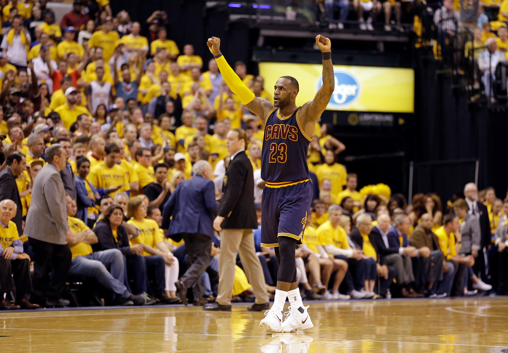 . Cleveland Cavaliers forward LeBron James (23) celebrates a basket during the second half against the Indiana Pacers in Game 3 of a first-round NBA basketball playoff series, Thursday, April 20, 2017, in Indianapolis. The Cavaliers defeated the Pacers 119-114. (AP Photo/Michael Conroy)