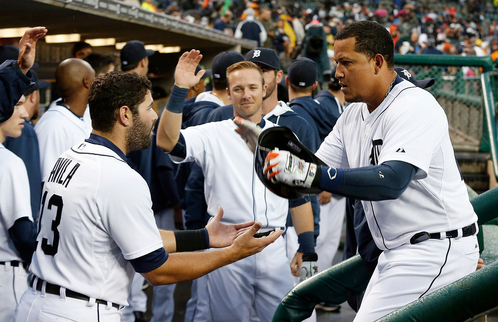 . Detroit Tigers\' Miguel Cabrera, right, celebrates his two-run home run off Houston Astros pitcher Brad Peacock with Alex Avila in the first inning of a baseball game in Detroit, Wednesday, May 7, 2014. (AP Photo/Paul Sancya)