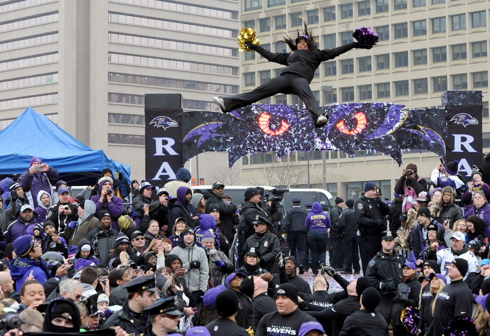 . A Baltimore Ravens cheerleader performs a stunt during a send-off rally for the team on Monday, Jan. 28, 2013 in Baltimore. The NFL football team is leaving for New Orleans to face the San Francisco 49ers in the Super Bowl. (AP Photo/Steve Ruark)