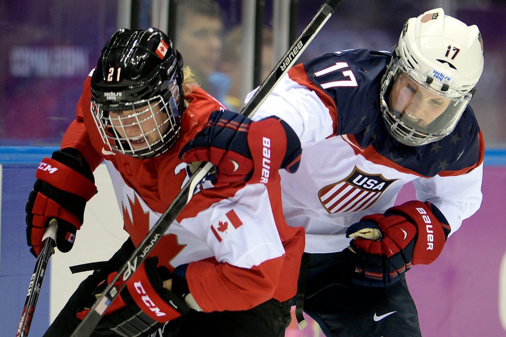 . Jocelyne Lamoureaux (17) of the U.S.A. defends Haley Irwin (21) of the Canada during the first period of the women\'s gold medal ice hockey game. Sochi 2014 Winter Olympics on Thursday, February 20, 2014 at Bolshoy Ice Arena. (Photo by AAron Ontiveroz/ The Denver Post)