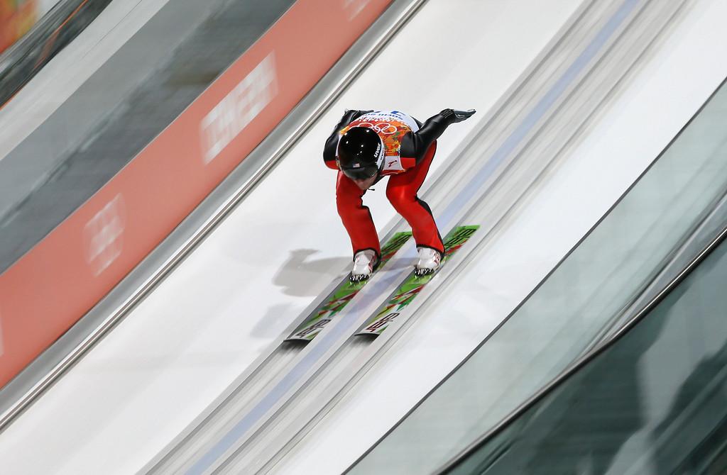 . Estonia\'s Kaarel Nurmsalu starts his first attempt during the men\'s normal hill ski jumping final at the 2014 Winter Olympics, Sunday, Feb. 9, 2014, in Krasnaya Polyana, Russia. (AP Photo/Dmitry Lovetsky)