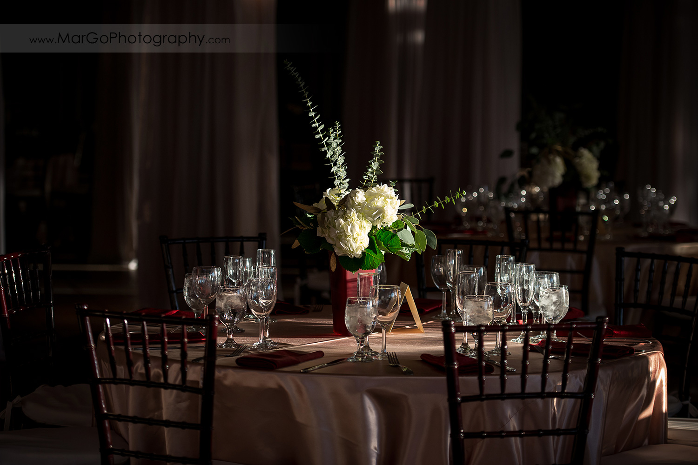 wedding table decor with white flower centerpiece at San Diego Marina Village