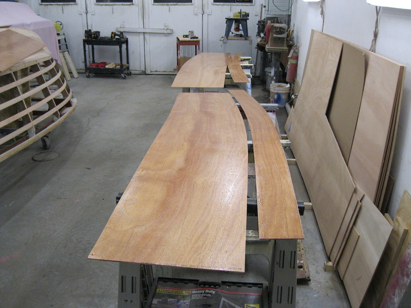 Applying epoxy to the inside of the plywood.