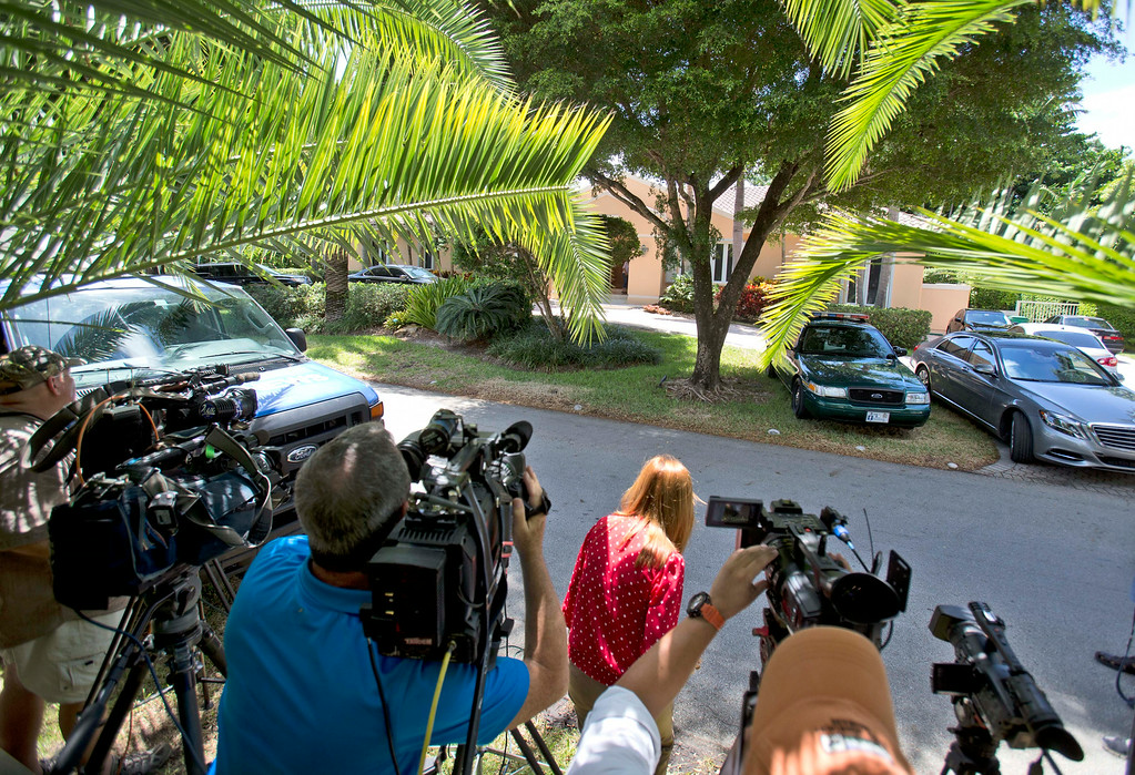 ". Television journalists stand across from the home of the family of journalist Steven Sotloff, Tuesday, Sept. 2, 2014 in Pinecrest, Fla. An Internet video posted online Tuesday purported to show the beheading by the Islamic State group of Sotloff, who went missing in Syria last year. In a two-sentence statement Tuesday, family spokesman Barak Barfi said Sotloff\'s family, quote, ""knows of this horrific tragedy and is grieving privately.\"" (AP Photo/Wilfredo Lee)"