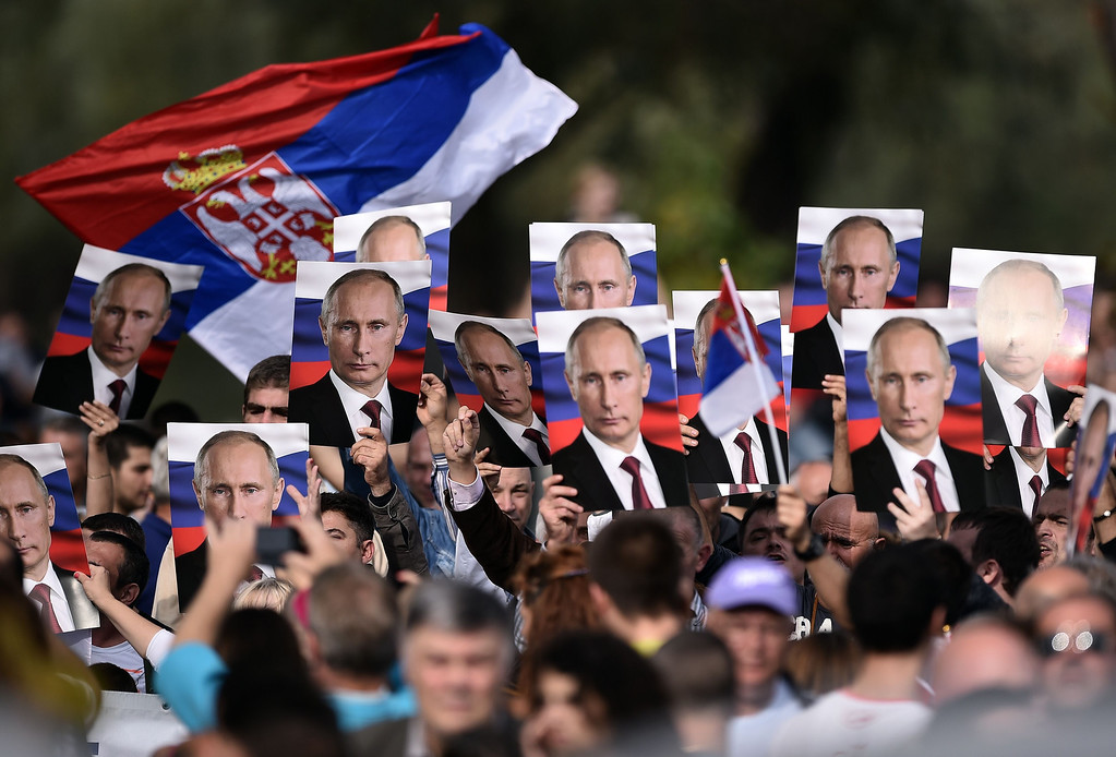 . Serbian nationalists hold posters showing Russian President Vladimir Putin ahead of a military parade in Belgrade on October 16, 2014. ANDREJ ISAKOVIC/AFP/Getty Images