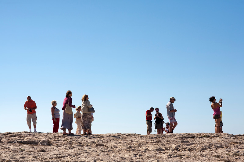 Visitors on the top of a cliff, cabo Sao Vicente (Cape Saint Vincent), town of Sagres, municipality of Vila do Bispo, district of Faro, region of Algarve, southwestern Portugal