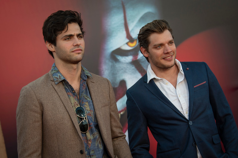 "WESTWOOD, CA - AUGUST 26: Matthew Daddario and Dominic Sherwood attend the Premiere Of Warner Bros. Pictures' ""It Chapter Two"" at Regency Village Theatre on Monday, August 26, 2019 in Westwood, California. (Photo by Tom Sorensen/Moovieboy Pictures)"