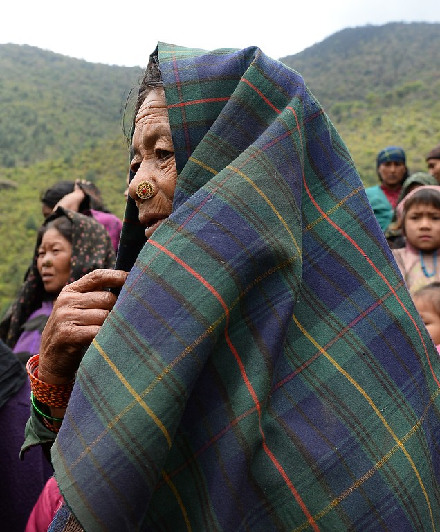 . Nepalese villagers wait for relief aid from an Indian Army helicopter at Uiya village, in northern-central Gorkha district on April 29, 2015.   Hungry and desperate villagers rushed towards relief helicopters in remote areas of Nepal, begging to be airlifted to safety, four days after a monster earthquake killed more than 5,000 people.    AFP PHOTO / SAJJAD  HUSSAIN/AFP/Getty Images