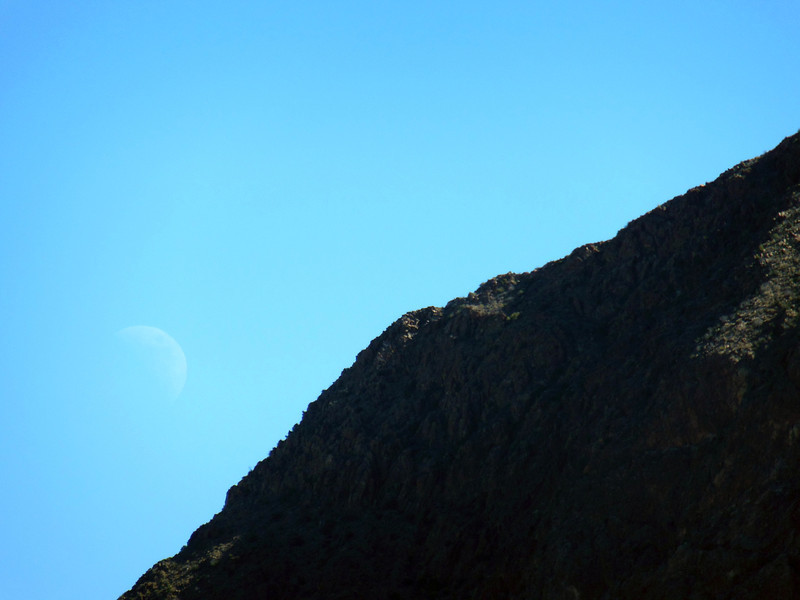 Barely visible moon over the N shoulder of Elephant Tusk.