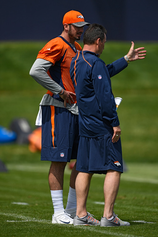 . Denver Broncos quarterback Paxton Lynch (12) talks with head coach Gary Kubiak during rookie minicamp May 6, 2016 at UCHealth Training Facility. (Photo By John Leyba/The Denver Post)