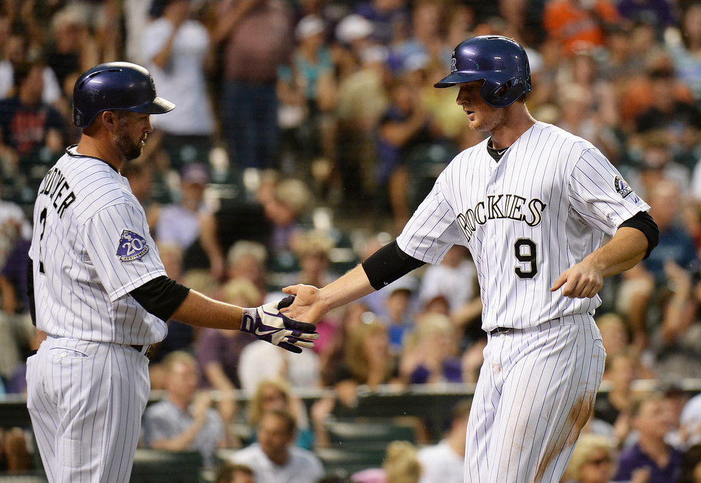 . DENVER, CO. - June 28: DJ LeMahieu of Colorado Rockies (9) celebrate his scoring with Michael Cuddyer (3) in the 1st inning of the game against San Francisco Giants at Coors Field. Denver, Colorado. June 28, 2013. (Photo By Hyoung Chang/The Denver Post)