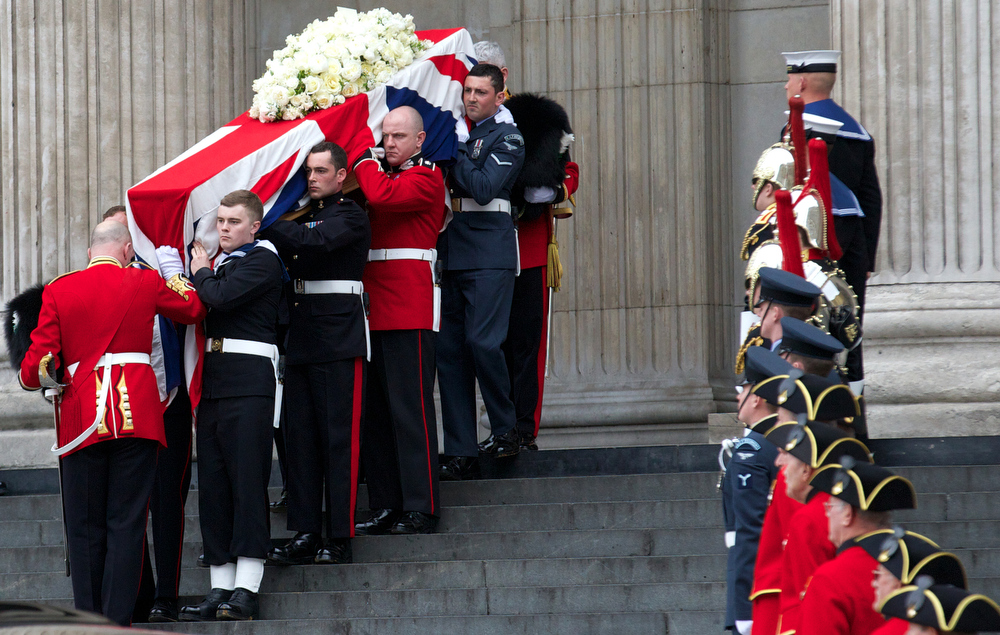 . The Bearer Party made up of personnel from the three branches of the military carry the coffin of British former prime minister Margaret Thatcher out of St Paul\'s Cathedral at the end of her ceremonial funeral in central London on April 17, 2013. The funeral of Margaret Thatcher took place on April 17, with Queen Elizabeth II leading mourners from around the world in bidding farewell to one of Britain\'s most influential and divisive prime ministers.  ANDREW COWIE/AFP/Getty Images