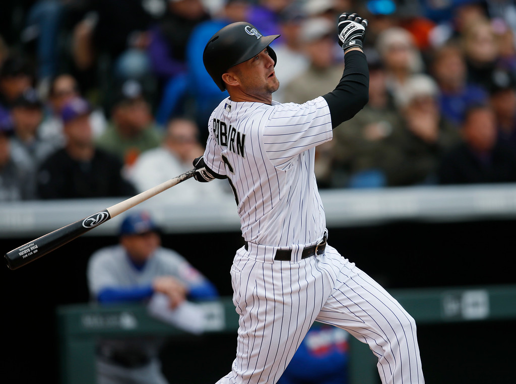 . Colorado Rockies pinch hitter Ryan Raburn follows the flight of his two-run home run off New York Mets relief pitcher Jim Henderson in the seventh inning of a baseball game Sunday, May 15, 2016, in Denver. (AP Photo/David Zalubowski)