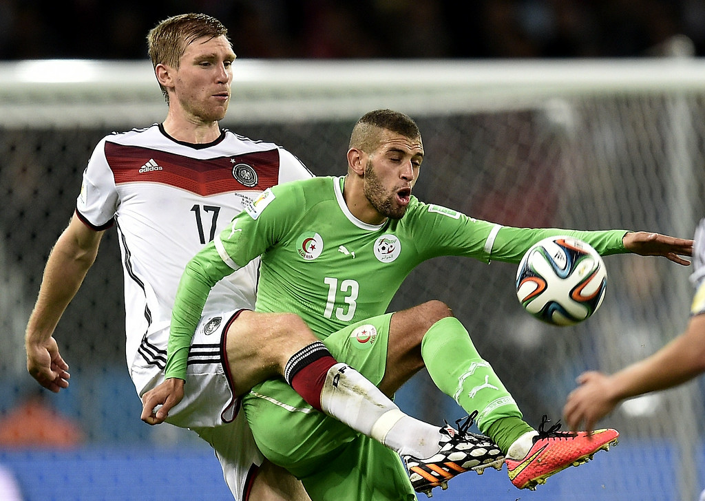 . Germany\'s defender Per Mertesacker (L) vies with Algeria\'s forward Islam Slimani during a Round of 16 football match between Germany and Algeria at Beira-Rio Stadium in Porto Alegre during the 2014 FIFA World Cup on June 30, 2014.   Lucas Uebel/AFP/Getty Images