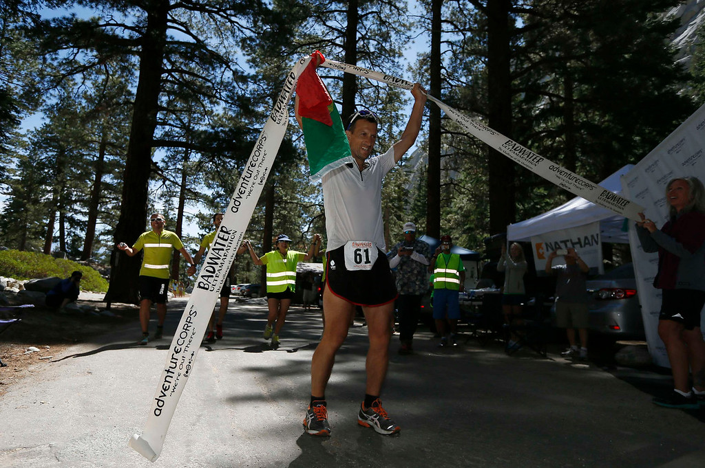 . Carlos Alberto Gomes De Sa of Portugal celebrates after winning the Badwater Ultramarathon at the foot of Mount Whitney, California July 16, 2013. The 135-mile (217 km) race, which bills itself as the world\'s toughest foot race, goes from Death Valley to Mount Whitney, California in temperatures which can reach 130 degrees Fahrenheit (55 Celsius).  REUTERS/Lucy Nicholson