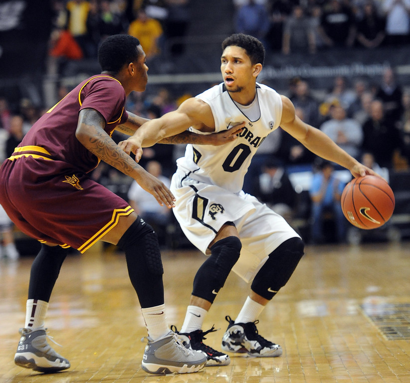 . Askia Booker of Colorado tries to get around Jahii Carson of Arizona State during the first half of the February 16th, 2013 game in Boulder. Cliff Grassmick / February 16, 2013